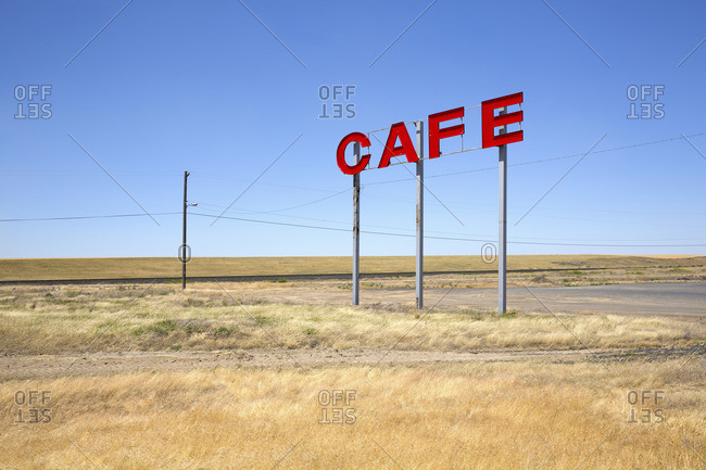Cafe sign in a field in Washington State