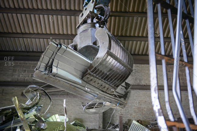 Low angle view of crane grab in aluminum recycling plant