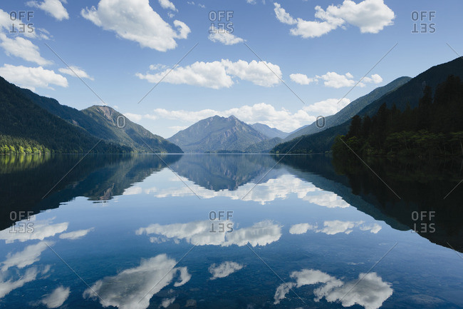 Mirror reflections, the sky and clouds reflected in the surface of the water of Lake Crescent