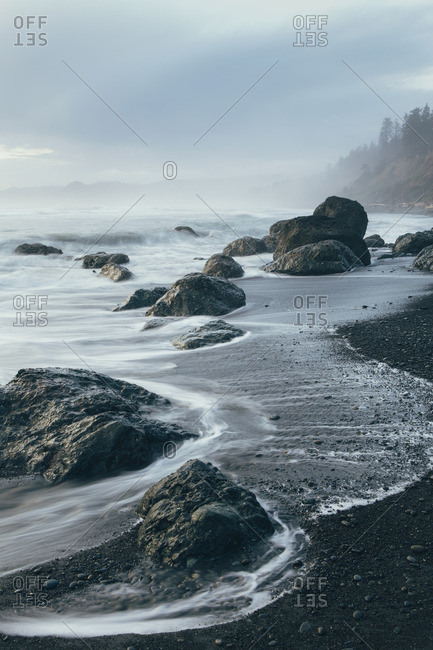 Rock formation on the coastline exposed on the beach at low tide Long Exposure