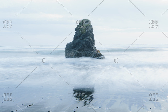 Rock formation on the coastline, exposed on the beach at low tide