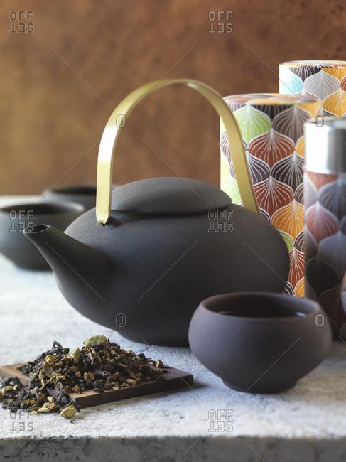 Loose tea with a set of stone tea cups and tea pot