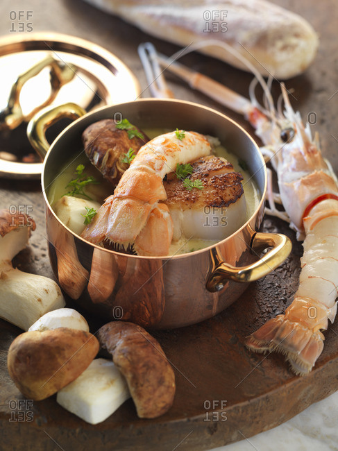 Langoustine and scallops in a broth of cream and porcini mushrooms
