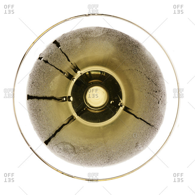Overhead view of a cocktail glass with condensation streaks