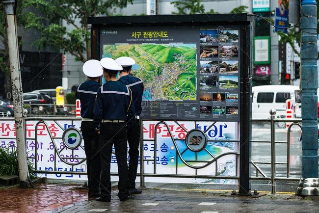5/24/16: Uniformed men by street map, Korea