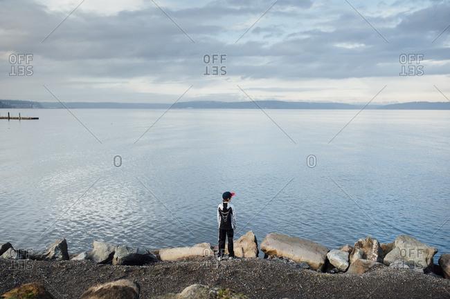 Boy standing on shoreline