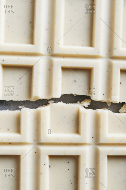 Close-up of a chocolate bar broken in half
