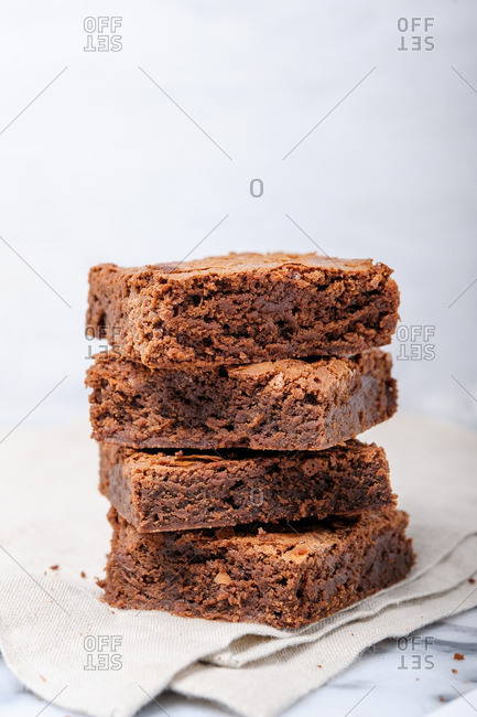 A stack of brownies on a table