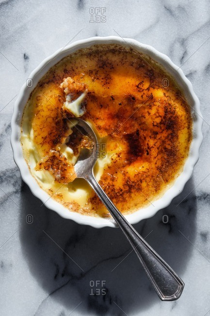 Creme brulee on a marble table