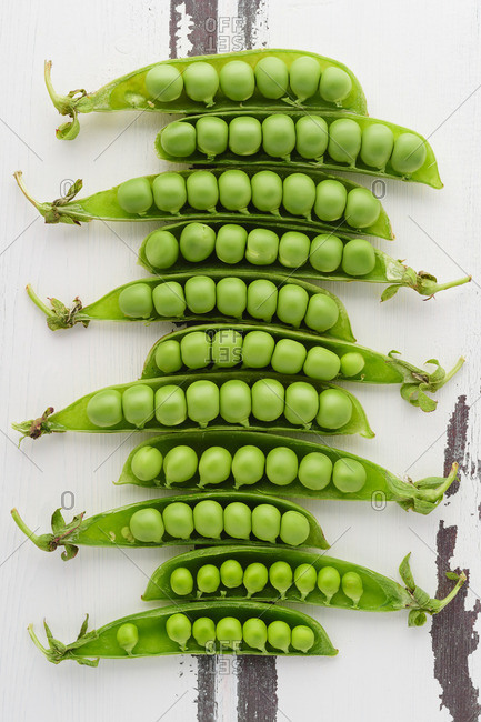 A row of pea pods on a table