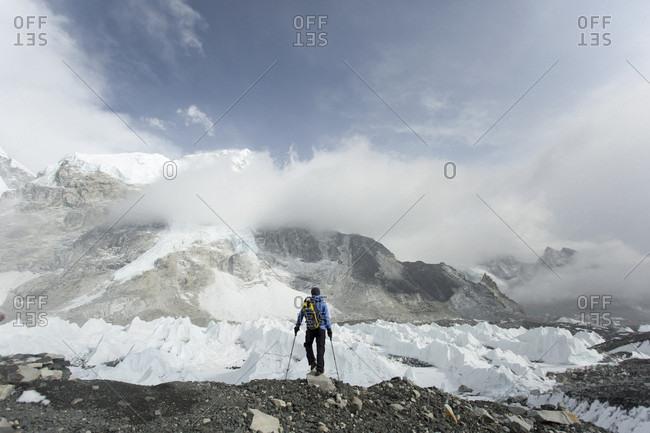 A trekker stands over the Khumbu Glacier in Everest Base Camp