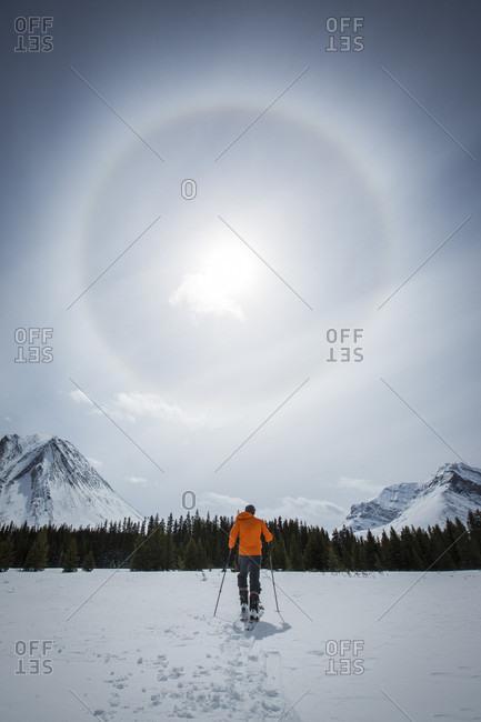 Cross country skiing under sun halo
