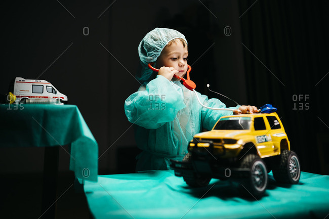 Young doctor healing a car