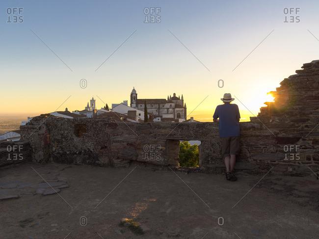Portugal- Senior man watching sunrise at Castel de Monsaraz