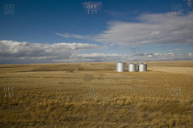 Three silos in an open field in Montana