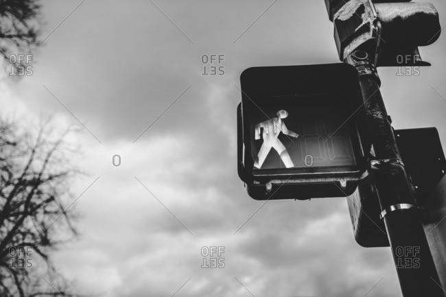 Crosswalk sign illuminating walk symbol