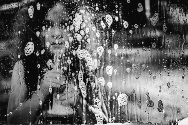 Little girl cleaning a window