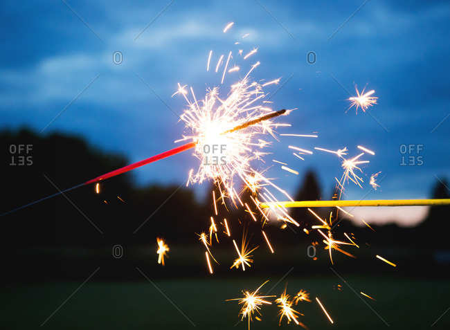 Two sparklers burning in close up