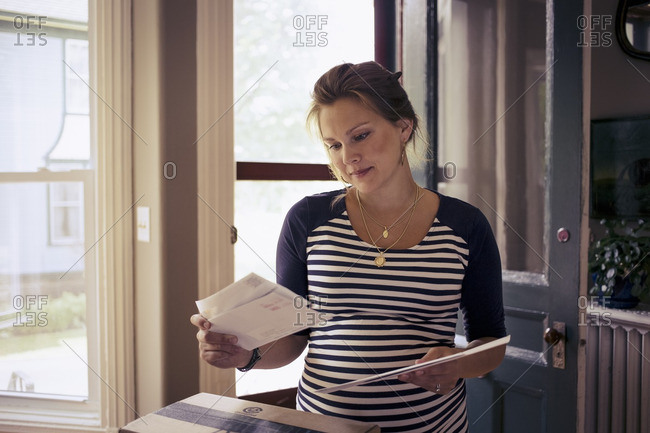 Pregnant woman with her mail