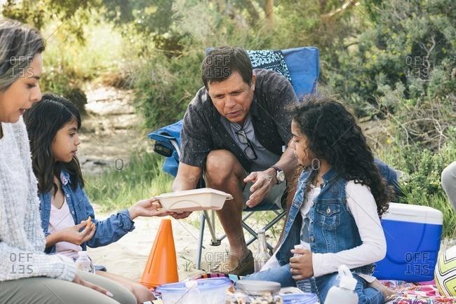 Family eating at beach picnic