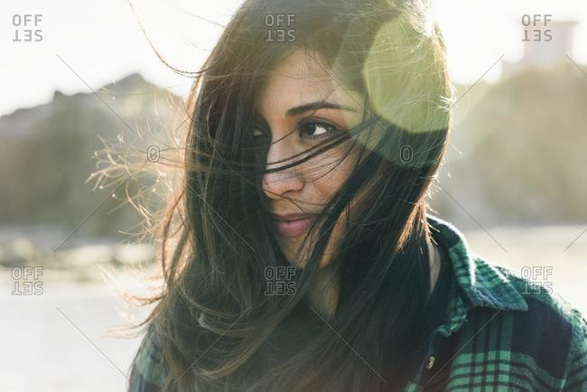 Portrait of Hispanic woman on beach