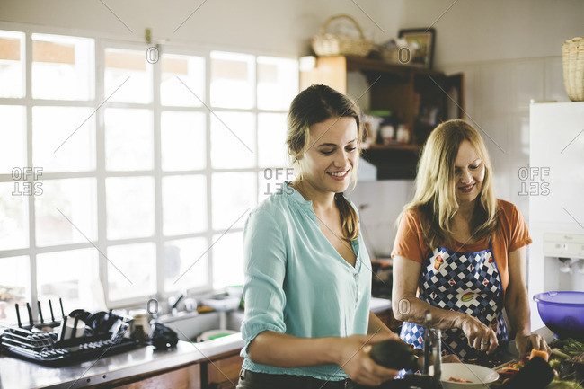 Two women cook together