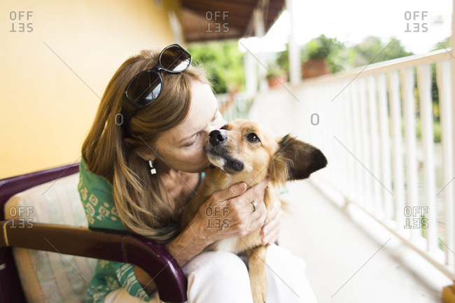 Woman being loving to her dog