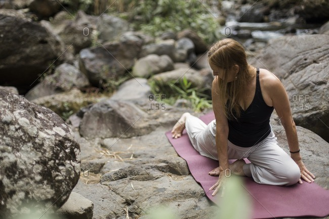Woman doing yoga in forest