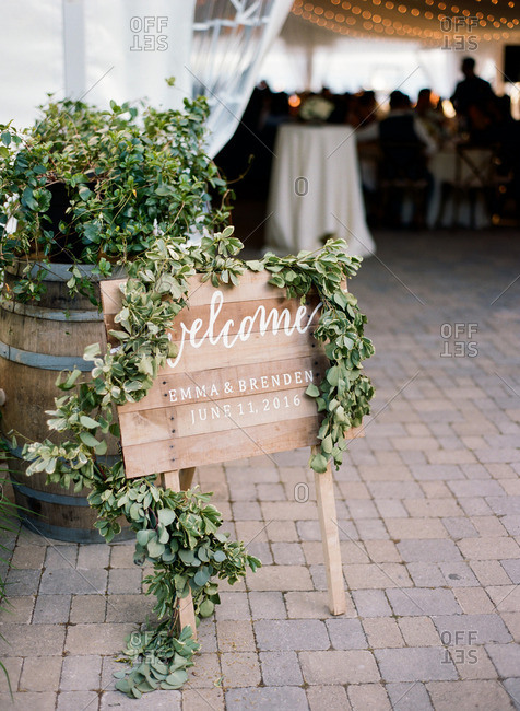 Rustic welcome sign at the entrance to a wedding reception
