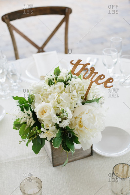 Centerpiece with table number on a table at a wedding reception