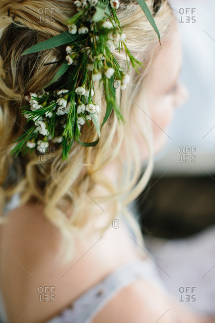 Greenery in a bridesmaid's hair for a wedding