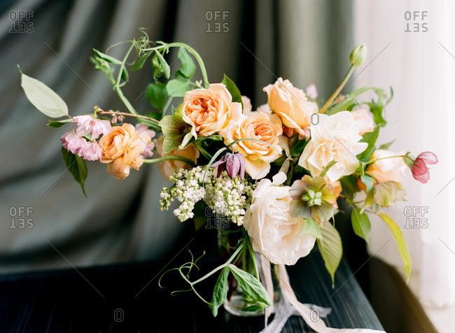 Close-up of a floral arrangement beginning to wilt