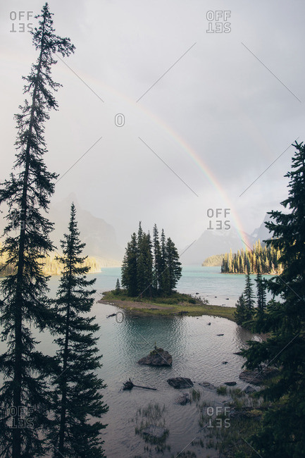 Rainbow over a mountain lake