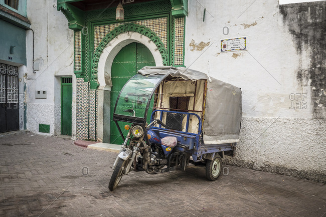 10/29/14: Motorized rickshaw parked near a building in Tangier, Morocco