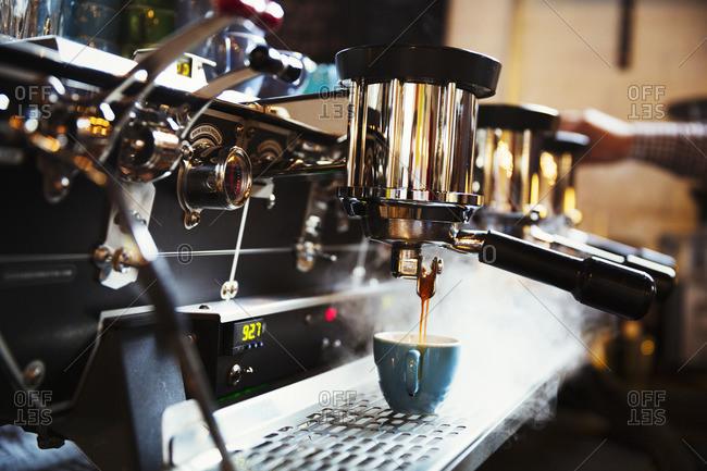 A coffee machine making coffee Steam and heat