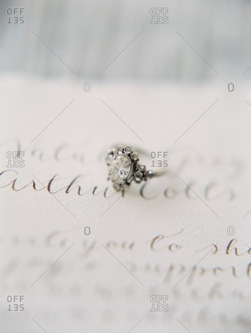 Diamond ring on writing