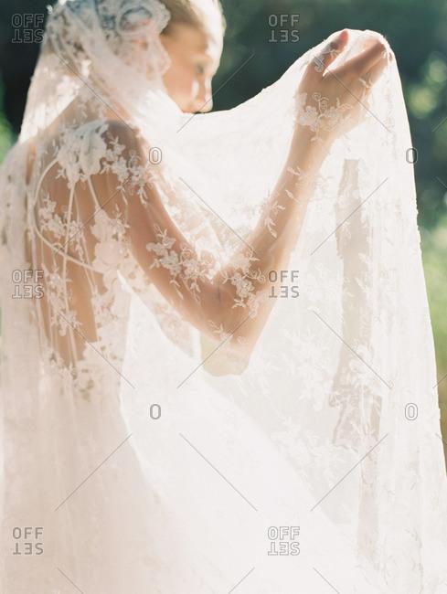 Bride with long lace veil