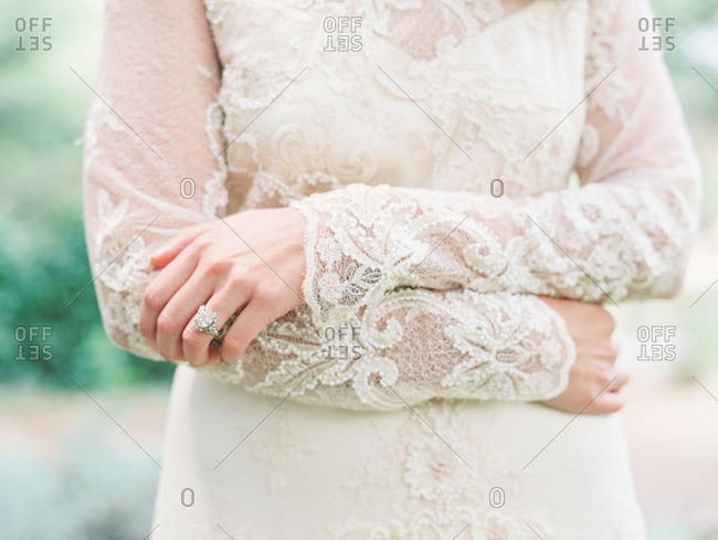 Bride with long lace sleeves