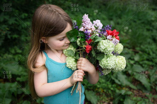 Girl holding summer flowers