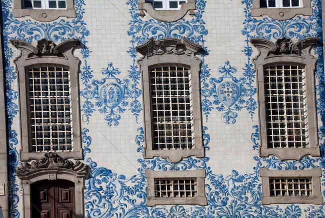 Porto, Portugal - April 10, 2013: Ornate tiling and windows of building