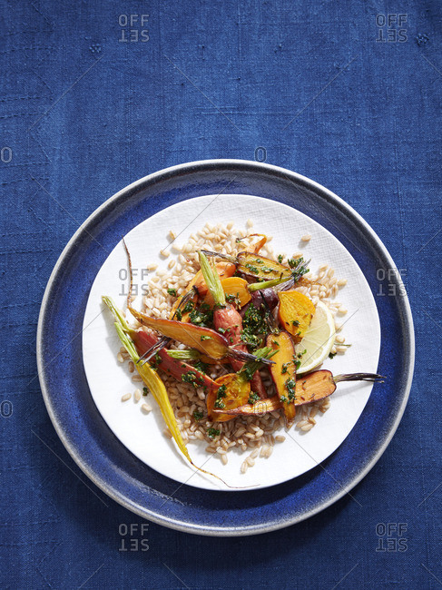 Carrot salad on a bed of farro