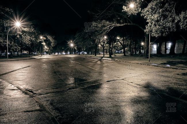 Wet city street at night in Brasilia, Brazil