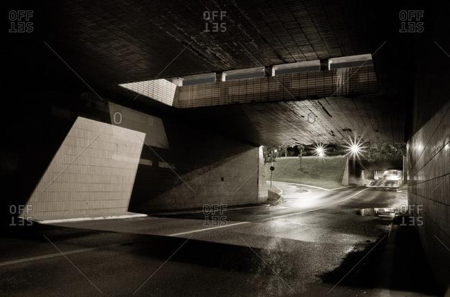 View of a bridge underpass on a wet night in Brasilia, Brazil