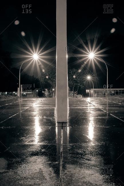 City street lights illuminated on a wet night in Brasilia, Brazil