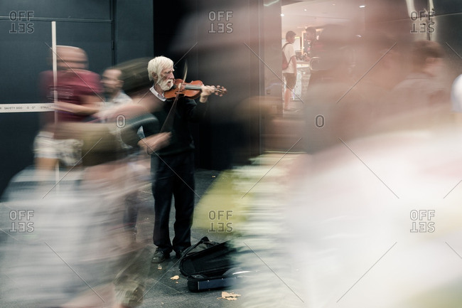 December 29, 2012: Man playing violin on a busy city street