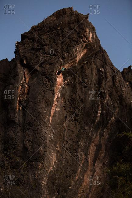 Man climbing up a large mountain at Serra da Bocaina National Park in Brazil