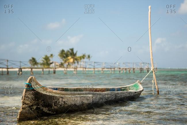 Old canoe moored on San Blas Islands of Panama