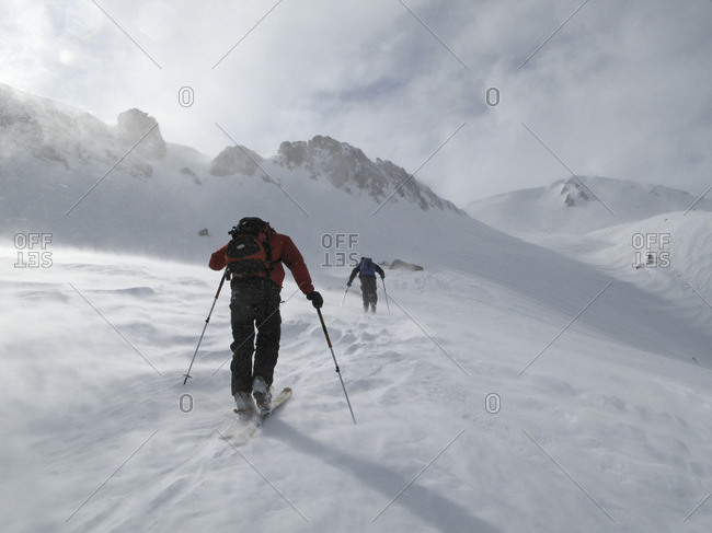 Cross country skiers in snow mountains