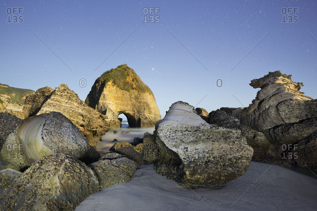 Wharariki Beach in moonlight, New Zealand