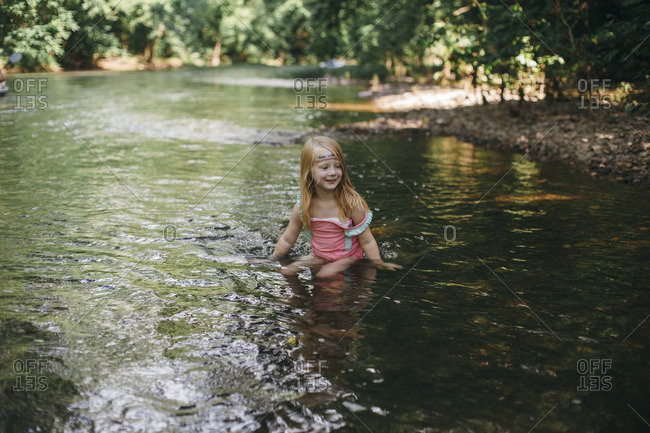 Girl swimming in a river